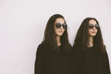 beautiful twins with round sunglasses