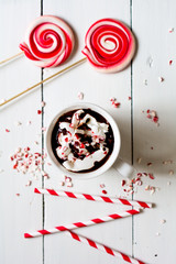 Cocoa and red-striped lollipop and straws