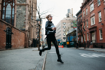 Young freelance runs through the streets of New York City