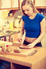 Woman preparing healthy breakfast making sandwich
