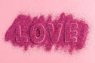 Love Message with Glitter on a Pink Background