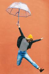 Woman enjoying in a rainy day.