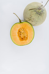 Close up view of a rock melon isolated on a white background.
