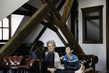 Grandma happily talking and spending time with her grandchildren