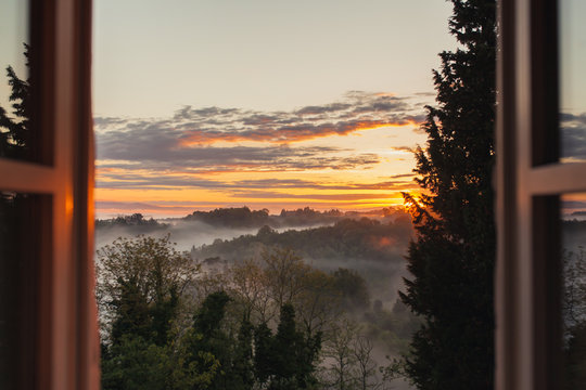 View from the window at sunrise in Tuscany