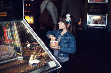 Girl playing the penny slot machine