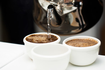 Brewing coffee with boiling water