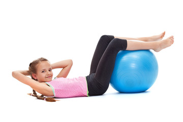 Photo sur Plexiglas Gymnastique Young girl doing sit ups with a large gymnastic ball