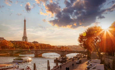 Fototapete - Paris with Eiffel Tower against colorful sunset in France