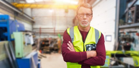 Composite image of portrait of senior worker wit arms crossed