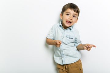 Boy having fun on studio grey background
