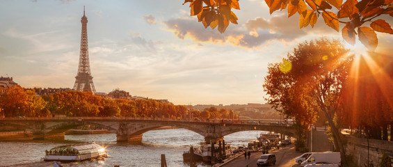 Fototapete - Paris with Eiffel Tower against autumn leaves in France