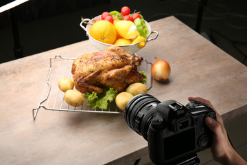 Woman taking photo of food with professional camera