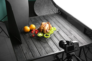 Photo studio with professional lighting equipment and camera for shooting food