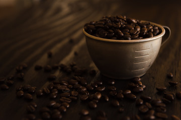Coffee beans in metal cup.