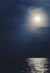 Full moon with the reflected light on the sea surface
