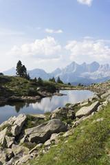 Lake Spiegelsee with mountain Dachstein on Reiteralm, austria