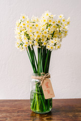 "jonquil flowers in a glass vase with a simple note attached reading ""thank you""""onquil flo	Gillian	3				4"