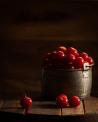 Cherry tomatoes in a metal pail.