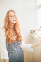 A young redhead girl in denim