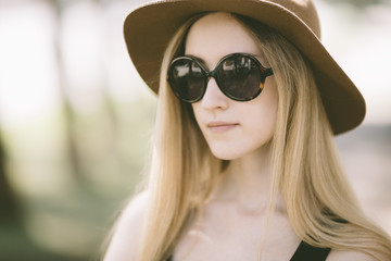portrait of real young woman with vintage sunglasses