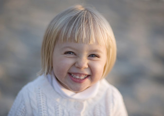 Blonde Girl With Pixie Haircut Giggling