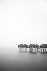 Small Houses Built on the Water Surrounded by the Fog
