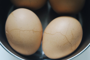 close up of cracked eggs