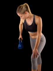 Young fitness woman exercise with kettle bell.