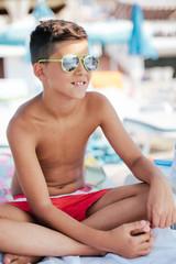 Boy sun bathing on the beach