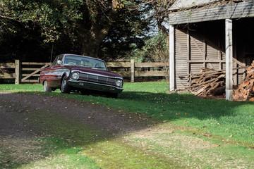 Vintage car parked at farm homestead