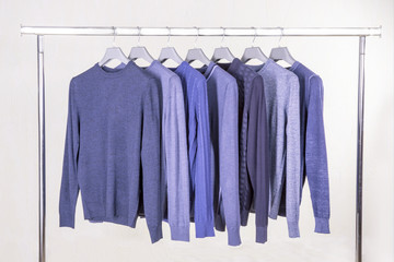 blue jumpers on the hanger in the store