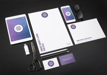 Tablet, Smartphone and Stationery on Dark Background Mockup 1