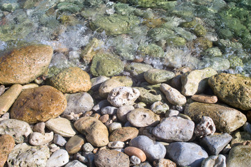 Stones on the seashore and in the water