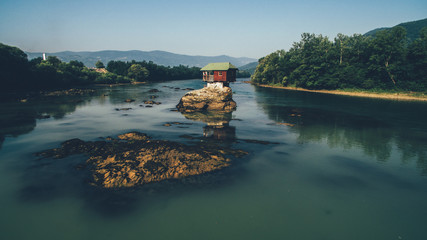 cottage on the rocks in the river Drina