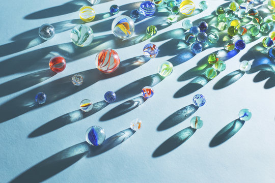 Colorful marble toy against blue background