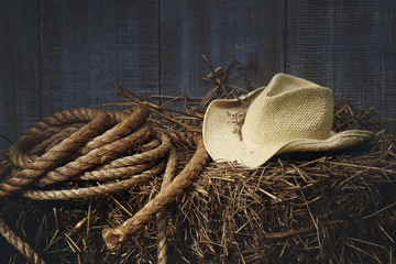 Western straw hat on a bale of hay