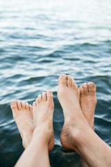 Feet near water