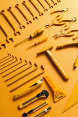 yellow work/handtools of a craftsman on yellow background.