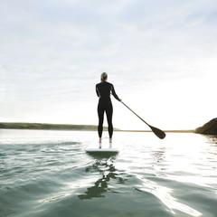 Female paddle boarder.