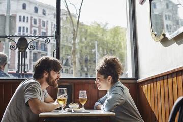 Loving Couple Sitting At Restaurant Table
