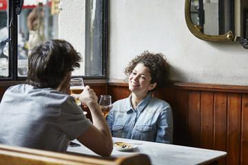 Couple Holding Wine Glasses In Restaurant