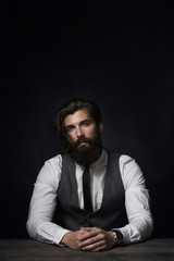Dark portrait of a stylish man