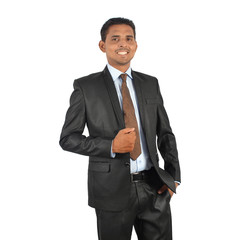 Portrait of a young smiling businessman in black suit standing over white background