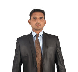 Portrait of a young businessman in black suit standing over white background