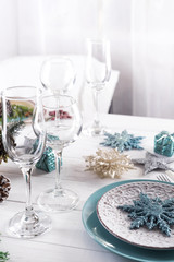 Table served for Christmas dinner in living room,