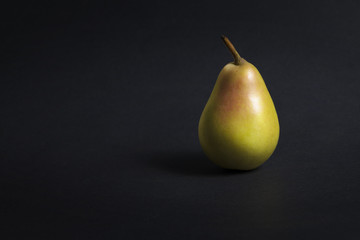 Reddish pear on a dark gray background