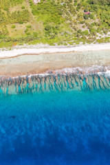 Aerial view of coastline of Bora Bora island with waves breaking on the shore
