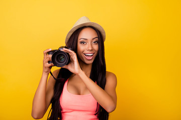 Charming cheerful dreamy afro traveller in casual outfit and beige head wear, so excited. Studio, chill, entertainment, dream, adventure, object, paparazzi concept lifestyle