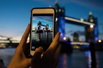 Tourist Taking Photo of Tower of London with Cellphone